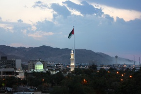 Aqaba at night with the green glow of the Mosque